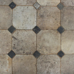 """Barr Montpellier or Barr gris - Rustic reclaimed French limestone floor made of large Barr limestone slabs cut into 16"""" octagons with inlaid antique black basalt 3"""" square cabochons."""