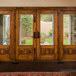 Canyon Road Remodel - The Doors (and a Gate) - Custom doors and surround incorporating antique carved panels and fragments.  Photo: Eric Swanson