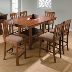 Jofran Saddle Brown 7 Piece Rectangular Counter Height Table Set - The Jofran Saddle Brown 7 Piece Rectangular Counter Height Table Set combines superb craftsmanship and welcoming charm. Clean open lines and delicately tapered feet distinguish these remarkable pieces; storage and display space beneath the table offer added functionality. Perfect for your dining room or kitchen this set includes a rectangular table with leaf for expanding and six matching chairs. It has been crafted from durable solid wood with a warm and inviting Saddle Brown finish. Each chair has been upholstered in durable rose fabric. Counter-height dining has become increasingly popular putting a distinctly modern twist on the classic dining set. At once practical and stylish this set is sure to complement your decor. It is ideally suited to traditional-style interiors. Additional chairs are available for purchase separately. Please note that some assembly is required. About Jofran Inc.Founded in 1986 Jofran distributes fine home furnishings in a variety of styles to suit your unique taste. This Norfolk Massachusetts-based company is known for their premium-quality materials and meticulous production methods. Assembly of each item is quick and simple. Taking inspiration from styles across the globe Jofran makes it easy to find a piece that suits your home decor.