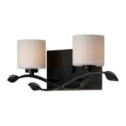 Quoizel Erin ERN8602IB Bath Fixture - 17W in. - Imperial Bronze - Bring a touch of the outdoors into your bathroom when you mount the Quoizel Erin ERN8602IB Bath Fixture - 17W in. - Imperial Bronze. The overall design is simple, with two glass cylindrical shades tempering the light of the bulbs. However, the interweaving branch accent with leaves add organic visual interest to the piece. The imperial bronze finish and beige shades ensure it will fit in with any bathroom color scheme. It even comes with two 75-watt halogen bulbs.About Quoizel LightingLocated in Charleston, South Carolina, Quoizel Lighting has been designing timeless lighting fixtures and home accessories since 1930. They offer a distinctive line of over 1,000 styles, including chandeliers, lamps, and hanging pendants. Quoizel Lighting is the perfect way to add an inviting atmosphere to any area in your home, both indoors and out.