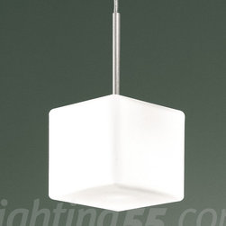 Itre - Cubi 11 Suspension - Modern, elegant and metropolitan. The Cubi suspension lamp looks best in chic and modern environments. This cube-shaped suspension lamp is composed of a layered and blown-glass diffuser with a satin finish.