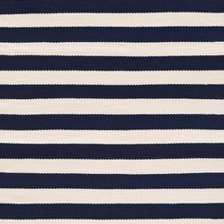 Trimaran Stripe Navy/Ivory Indoor/Outdoor Rug - The lean scale of the pattern on the Trimaran rug from Dash & Albert adds a tailored touch to the relaxed look of nautically striped rugs. This durable, easy-to-clean indoor/outdoor polypropylene construction and coolly classic navy-and-white combination speak of barefoot simplicity and timeless summer days by the shore. Grace any room with this classic style to breezily set an effortlessly beachy-chic tone at home.