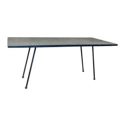 Pre-owned Mid-Century Modern Coffee Table with Formica Top - This Mid-Century Modern cocktail table with a gray formica and wood grain tabletop will flatter an array of interior styles. The black steel legs contrast nicely with the wooden top and give this piece just the right amount of spunk.      Small nick on tabletop as pictured above.