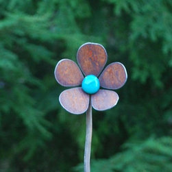 Flower Squiggle Stakes Single Flower With Glass - This little flower garden stake stands out with its turquoise center. It provides a bright spot of color surrounded by rusted petals. It's a great little flower to add to the garden.