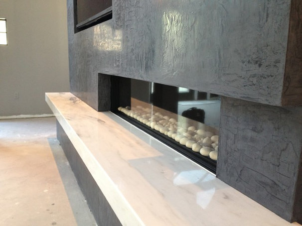 Contemporary Indoor Fireplaces by Elegant Fireside and Patio llc