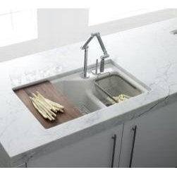 "Kohler - Kohler K-6411-2K-0 White Indio Indio 33"" Double Basin Under-Mount - Product Features:Double basin sink with a 80/20 split provides increased versatility for any taskCovered under Kohler s limited lifetime warrantyThe large/medium basins allow you to keep clean and dirty dishes separate, while providing ample room for oversized pots and pansTwo bottom basin racks, a colander, and a walnut cutting board are included and custom-fit to work perfectly with the sinkConstructed of enameled cast-iron which combines strength, durability and insulation benefitsUnder-mount installation gives an integrated graceful look to the sinkOffset drain location increases workspace area in the sink as well as storage area underneathAll hardware needed for installation includedProduct Technologies / Benefits:Enameled Cast-Iron:  Kohler Enameled Cast-Iron combines the strength, durability, and insulation benefits of cast-iron with the scratch, chip, and burn resistance of a baked, powder coat finish and comes with an exceptional Lifetime Limited Warranty. When these materials are combined it gives the sink or tub the strength to last a lifetime of use. Kohler Enameled Cast-Iron is also available in a wide variety of specialty colors allowing you to truly customize your home.Smart Divide:  The basin divider is set to a lower height than perimeter of the sink; you gain the convenience of a single basin sink completely filled, without losing the functionality of a double basin sink. The lower divider also gives more room for working with larger pots and pans providing more access for filling and cleaning.Product Specifications:Height: 9-3/4"" (measured from the bottom of the sink to the top most point of the sink)Overall Width: 21-1/8"" (measured from the back outer rim to the front outer rim)Overall Length: 33"" (measured from the left out"