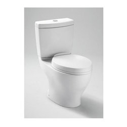 Toto - Aquia II Dual Flush Toilet (Bone) - Color: Bone. This is a tank and bowl only. Toilet seat is not included. Transitional style. Elongated skirted design. 1.6 and 0.9 gpf dual-max flushing system. Chrome plated push button style flush. Large 2.13 in. fully glazed concealed trapway. WaterSense certified. Meets and exceeds ASME A112.19.2/CSA B45.1, ASME A112.19.14 standards. IAPMO(cUPC), EPA WaterSense, State of Massachusetts and others certifications. UPC, IPC, NSPC, NPC Canada and others code compliances. California Green Building Code, City of Los Angeles Water Efficiency Ordinance and others legislative compliances. Made from vitreous china. Minimum water pressure: 8 psi (static). Water surface: 6 in. L x 4.5 in. W. Trap: 2.13 in. Dia.. Trap Seal: 2.13 in.. Rough-in: 12 in.. Installation and Owners Manual