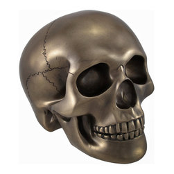 Smooth Bronzed Skull Statue - This smooth bronzed skull is an excellent addition to any skull collection. Made of cold cast resin, it measures 5 inches tall, 6 1/2 inches long, and 4 1/2 inches wide. The shape of the skull is wonderfully detailed with well defined cranial bones and a finish that is sure to complement most any decor. This piece is an awesome accent to bookcases, shelves, tables or desks in your home or office that is sure to be admired. It is also a thoughtful gift for a skull loving friend.