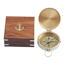 Handcrafted Nautical Decor - Brass Gentlemen's Compass 4'' - The Hampton Nautical Pocket Compass is truly a great gift to any nautical enthusiast in your life.This timeless navigational piece i solid brass, and can be stored in one's pocket or in the solid rosewood box.----Press the push button to reveal the compass. The compass needle is accurate, quick, and responsive. The cap can be closed at any time. --This solid brass compass comes with a rosewood box that has the Hampton Nautical anchor with rope logo embedded into the top. The box is a smooth and polished finish wood with a green felt on the inside to protect the compass.--Dimensions: 4'' L x 3'' W x 1'' H (measurement includes brass ring on top of compass)--------    Fully functional solid brass compass--    Rosewood box inset with brass anchor on top--    Hinged lid closes to protect compass--    Custom engraving/photo etching available: Logos,  pictures or slogans can be easily put on any item. Typical minimum  custom order is 100+ pieces. Minimum lead-time to produce and engrave is  4+ weeks.----