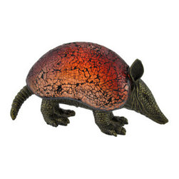 Crackle Glass Armadillo Accent Lamp - This armadillo lamp is a unique accent to your home, and is sure to start a conversation! The base is made of cold cast resin and has an antique bronze finish, while the crackle glass shade casts a soft red glow. The lamp measures 5 1/2 inches tall, 9 3/4 inches long, 3 3/4 inches wide, and has a 6 foot long black power cord with a toggle on/off switch. Foam pads on the bottom of the lamp prevent it from scratching your furniture, and a 7 watt Type T bulb is included. This accent lamp complements Southwestern decor beautifully, and makes a great gift for a friend.