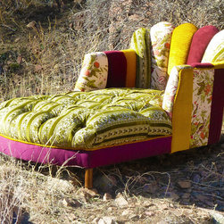 Vintage Patchwork Channel Tufted Chaise Lounge - This is hands down the most amazing and eclectic of our Vintage Renewal creations as of yet!  I am sure you will love it as much as we do!  This recycled chaise has been completely deconstructed and rebuilt to include a wonderful fanned channel back in a vibrant array of hand picked and patchworked one-of-a-kind vintage fabrics.  The seat interior has been tufted in a lush emerald and ivory luxurious vintage fabric. The welt cord running throughout the piece is in a lush pile vintage gold fabric.  The burgandies, golds and emeralds are so fabulous together creating a true work of art that will wow all of your guests.