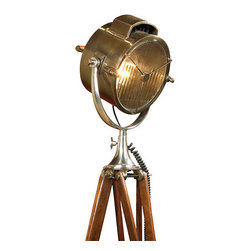 Thos. Baker - coast guard patrol searchlight - As always searching for the lucky find, the original of this 1930s Navy spotlight was unearthed in an antique store in Greenwich, England. In a way the light is a wonderful combination of old technology, romantic seafaring and practical lighting. Perched on its imposing rosewood tripod the light dominates, adding character to any room�