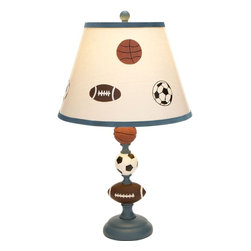 Benzara - Classic Metal Table Lamp accented in Blue Beige Color - Make your kid's bedroom tidy with this metal table lamp. Accented in blue, this beige colored lamp has football, baseball and basketball graphics imprinted on it. If your kid is a sports fan then this lamp is a perfect addition to his room. It adds color and liveliness to the setting. You can place this lamp on the side table or on the mantle to give a mellow and subdued effect. The lamp is equipped with authentic electrical fittings to make it functional. Space efficient and admirable in looks, this elegant table lamp is apt to keep your study room or living space clutter free. Sturdy in construction, this metal lamp ensures a long shelf life. It is highly durable in make and is constructed out of quality metal. Moreover, this table lamp is a good gifting option for kids.