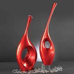 Bright Red Contemporary Vase Sculpture - Red is the color of power and passion, and this Bright Red Contemporary Vase Sculpture is the perfect way to invoke those sentiments in your home.About the Howard Elliott Collection.The Howard Elliott Collection is one of the premiere manufacturers of decorative mirrors and accessories in the home furnishings industry. Howard Elliott offers innovative designs in a wide variety of styles, and the company prides itself on its high standards and quality. No matter your style, the Howard Elliott Collection offers pieces that are sure to add sophistication and luxury to your decor.In the company's meteoric rise, it now ships to nearly 3,500 furniture, home furnishings, and lighting retailers as well as many of the top contract companies servicing the hotel and building industries worldwide.