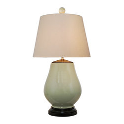 """Lamps Plus - Contemporary Ceramic  Pale Green Table Lamp - The ceramic base is a lovely distressed pale green. The beige fabric that wraps around the hardback shade perfectly complements the overall color scheme. A single 100 watt bulb is needed to bring in light to any room of the house! Contemporary table lamp. Pale green ceramic. Light mango wood details.  Ivory linen fabric rectangle hardback shade. On-off switch. Maximum 100 watt bulb (not included). 27"""" high. Lamp shade measures 18"""" across bottom.  Contemporary table lamp.  Pale green ceramic.  Light mango wood details.  Ivory linen fabric rectangle hardback shade.  On-off switch.  Maximum 100 watt or equivalent bulb (not included).  27"""" high.  Lamp shade measures 18"""" wide at the bottom."""