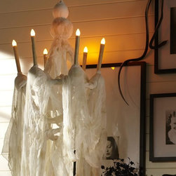 Mystic Falls Lit Taper Chandelier - Add this ragged chandelier and everyone will wonder where you hid the mummy.
