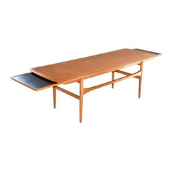 Pre-owned Arrebo Mobler Teak Coffee Table - A beautiful Arrebo Mobler Danish teak coffee table from the 1960s. This table features a pure organic design with curved frame, great lines, and extending black melamine leaves at each end.    The table is in good original condition. It could use refinishing of the wood, otherwise it is sturdy and in very good condition. The price reflects the need to refinish wood.