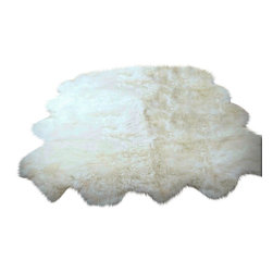Fur Accents - Plush Faux Fur 8 Pelt Sheepskin Accent Rug, Octo Design, Off-White, 5' x 8' - A Truly Luxurious Accent Rug. Rich Shaggy Off White Faux Sheepskin Area Carpet. 8 Pelt OCTO Design. Made from 100% Animal Free and Eco Friendly Fibers. Perfect for the Winter Lodge, Log Cabin or Family Great Room. Real Animal Fur Has natural oils which can become magnets for dust and dirt. When washed the oil is removed but then the skin becomes dry, brittle and matted. Be Kind to Animals ALWAYS BUY FAUX! Tastefully designed and fully lined with real Parchment Ultra Suede. Luxury, Quality and Unique Style for the discriminating designer / decorator.