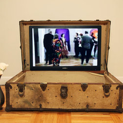 Redesigned Steamer Trunk TV Stand by San Fran Studios - Look at this clever update on the trunk! Part trunk and part TV, this steamer contains a flush-mounted flat-panel TV and stereo inputs.