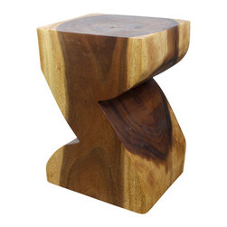 Kammika - ZAT End Table 12x14x20 inch H Sust Monkey Pod Wood w E Friendly Livos Walnut Oil - Our Sustainable Monkey Pod Wood ZAT 12 inch x 14 inch x 20 inch height End Table with Eco Friendly Livos Walnut Oil Finish is a solid carved piece of wood shaped as the letter Z in a fun font. Livos Walnut Oil is hand rubbed creating a water resistant and food safe matte finish. These natural oils are translucent, so the wood grain detail is highlighted. Color ranges from medium to dark Walnut brown tones that will darken as the wood ages. This sturdy piece serves wonderfully as an end table or stool. Made from the branches of the quick-growing Acacia tree in Thailand, where each branch is cut and carved to order (allowing the tree to continue growing), the wood is dried, carved and sanded by skilled artisans. Each piece is a Work of Art, Functional Sustainable Wood Eco Friendly Art! Craftspeople from the Chiang Mai area in Northern Thailand create these unique pieces with the simplest of tools. After each Monkey Pod wood (Acacia, Koa, Rain Tree grown for wood carving) piece is kiln dried, carved and sanded, it is rubbed in Livos Walnut oil creating a water resistant and food safe finish. There is no oily feel and cannot bleed into carpets, as it contains natural lacs. We make minimal use of electric hand sanders in the finishing process. All products are dried in solar or propane kilns. No chemicals are used in the process, ever. After each eco friendly piece is carved, kiln dried, sanded, and rubbed with Livos all natural oil, they are packaged with cartons from recycled cardboard with no plastic or other fillers. As this is a natural product, the color and grain of your piece of Nature will be unique, and may include small checks or cracks that occur when the wood is dried. Sizes are approximate. Products could have visible marks from tools used, patches from small repairs, knot holes, natural inclusions or holes. There may be various separations or cracks on your piece w