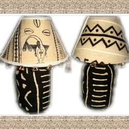 "Wedding Gifts Bride and Groom Undressed Back Lamp Set - TEDDEEZtm Mud cloth Lamps has Bride Lamp dressed in beautiful white dress with pretty gold flowers. The shade has real hair and removable hat with veil. One side is white brocade while the other is white mud cloth. Gold tone bells and fertility pieces accessorize its edges. Undress the base to white mud cloth on one side with black print. Adorned with champagne bottle and glass, brooms, white doves, our wedding day ribbon. Turn it around you have black mud cloth with white stripes. The Groom wears a sharp White three piece suit, and carries cowrie shells and rings in the hands. The shade is white mud cloth, its edges have gold tone bells. The base is white mud cloth with black print on one side and black mud cloth with white stripes on the opposite side. The front has champagne, with burgundy butterflies in the champagne glass. The Brides maids are dressed in darling off white dresses and little matching removable bonnets. Undress each of them to gold, rust and black mud cloth. One side has champagne glass and bottle, rings and brooms. Each shade matches the base. The Groomsmen are rust, gold and black mud cloth. champagne bottle and glass accessorizes one side, including gold tone bell. Each comes with matching shade. Lamps can be displayed in numerous ways. With cloths, with or without hair and veil, without cloths, all white, all black, white top black bottom, black top white bottom. Each lamp Stands 18""h, has a glass base and uses a 60 watt bulb, made in the U.S.A.. The gift that will be talked about for years to come. Comes separately also."