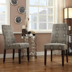 Inspire Q - Inspire Q Eaton Wave Back Blue Print Parson Chairs - Set of 2 - E595CF29(3A)[2PC - Shop for Dining Chairs from Hayneedle.com! The Inspire Q Eaton Wave Back Blue Print Parson Chairs - Set of 2 offers a touch of the exotic around your dinner table. This set includes two updated parson style chairs with modern waved backs spacious seats and exposed legs in dark brown. The fabric upholstered seats and backs come in a handsome blue and cream pattern.About Inspire QGet the designer look you've always dreamed of with help from the minds behind Inspire Q. Dedicated to creating pieces for your home that showcase your true style Inspire Q can serve as a valuable resource for finding both beautiful and comfortable home furnishings. With collections designed to inspire step-by-step resource guides and furnishings you'll love Inspire Q will surely become a go-to brand when it comes to the continued evolution of your dream home.