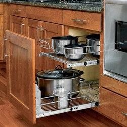 "Double Pull-out Basket In Chrome Wire For 18"" Base Cabinet - Width 14.75"" Height 19"" Depth 22"".  Double sliding baskets for base cabinet applications. This will fit a 18"" base cabinet.  Advantages and benefits. Features full-extension slides with ball bearings to make reaching your items easy.. Ideal for organizing your pots, pans, and other bulky items.. Heavy-duty chrome-plated frame adds durability and a polished look to any kitchen.. Easy assembly: installs with seven screws.. Max load is 100lbIncluded Product(s) . 2 baskets. 2 pairs of full-extension slides. 2 U-brackets. Adjustable rear mounting bracket"