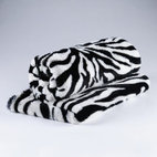 Zebra Print Faux Fur Throw - Curl up under a whimsical faux-fur throw for an evening by the fire.  Don't forget the hot chocolate a great book.