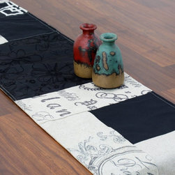 Chooty & Co. - Chooty and Co Anna's Black Random Pieced Table Runner - RRL72249B - Shop for Runners from Hayneedle.com! A patchwork of patterns the Chooty and Co Anna's Black Random Pieced Table Runner is crafted of a sturdy poly/cotton blend in chic black and white. Featuring embroidered florals chic Parisian lettering and solid prints this eclectic table runner is made in the USA. Hand-wash or spot-clean.About Chooty & Co.A lifelong dream of running a textile manufacturing business came to life in 2009 for Connie Garrett of Chooty & Co. This achievement was kicked off in September of '09 with the purchase of Blanket Barons well known for their imported soft as mink baby blankets and equally alluring adult coverlets. Chooty's busy manufacturing facility located in Council Bluffs Iowa utilizes a talented team to offer the blankets in many new fashion-forward patterns and solids. They've also added hundreds of Made in the USA textile products including accent pillows table linens shower curtains duvet sets window curtains and pet beds. Chooty & Co. operates on one simple principle: What is best for our customer is also best for our company.