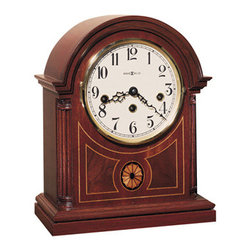 HOWARD MILLER - Howard Miller Barrister Mechanical Mantel Clock - Mahogany finish on select hardwoods and veneers with an intricate oval inlay of variegated maples and madrona burl.