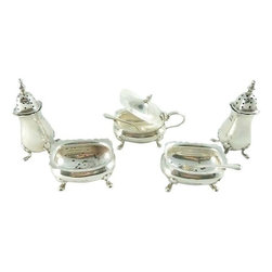 Reid & Sons - Consigned Antique Sterling Silver 7-Piece Condiment Set - A Royal Warrant will spice up any condiment set. It includes 7 pieces including a sterling footed set of salt and pepper cellars, a mustard pot and spoons from Reid & Sons, goldsmiths to the Queen. The set is in very good vintage condition with some pitting appropriate to age and use.