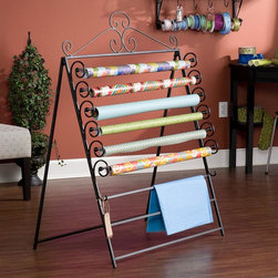 """Holly & Martin - Evelyn Easel/Wall Mount Craft Storage Rack in - 6 movable racks for standard size 30 in. wrapping paper. 2 fixed racks for tissue paper. Converts easily from an easel to a wall mount unit. Made from metal. Black finish. Standing dimension: 34.75 in. W x 27.5 in. D x 46.25 in. H (13 lbs.). Assembly InstructionsThe perfect solution for storing you wrapping paper and tissue paper this easel is a must have for any craft room. Featuring a beautiful scroll work design this easel can hold up to six standard 30"""" rolls of wrapping paper and has two addition racks to hang tissue paper on. This easel also conveniently converts to a wall mount storage unit to fit your needs. Add one to your home today!"""