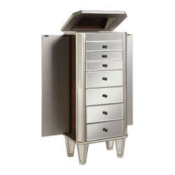 Powell - Mirrored Jewelry Armoire - This modern jewelry armoire provides ample safe storage space for all of your bits and baubles.The top opens to reveal a mirror to help you adorn yourself! Finished in a bold silver and accented with mirror, this piece is both eyecatching and fun. Features: -Silver and Mirror finish. -Modern design. -Top opens to reveal a mirror. -Provides ample storage space for all your treasures. -Some assembly required.