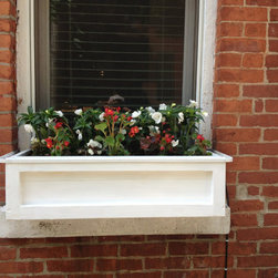 New York Roof Top Garden Services and Garden Designs :NYPlantings - Outer window designed with flower plants to increase the look of the building by New York Plantings Garden Designers and Landscape contracting