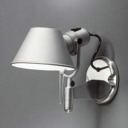 "Artemide - Artemide Tolomeo wall spot wall sconce - The Tolomeo wall spot wall sconce fromArtemide has been designed by Michele De Lucchi and Giancarlo Fassina. This wall mounted luminaire is great for adjustable direct and indirect incandescent lighting. The Tolomeo wall spot is composed of high polished aluminum. The diffuser is constructed of matte anodized aluminum, which is fully adjustable, rotatable and tiltable. The Tolomeo wall spot is the perfect choice for anyone seeking elegance and versatility. On/Off switch incorporated on lamp holder. UL listed.  Product Description:  The Tolomeo wall spot wall sconce fromArtemide has been designed by Michele De Lucchi and Giancarlo Fassina. This wall mounted luminaire is great for adjustable direct and indirect incandescent lighting. The Tolomeo wall spot is composed of high polished aluminum. The diffuser is constructed of matte anodized aluminum, which is fully adjustable, rotatable and tiltable. The Tolomeo wall spot is the perfect choice for anyone seeking elegance and versatility. On/Off switch incorporated on lamp holder. UL listed.  Details:     Manufacturer:  Artemide   Designer:  Michele De Lucchi and Giancarlo Fassina   Made in: Italy   Dimensions:   Height: 9"" (23cm) X Width: 7.75"" (20cm) x shade D: 6""     Light bulb:   1 X 100W incandescent     Material  aluminum"