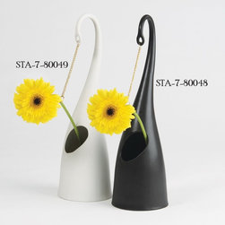 Studio A - Studio A 7.80049 Daisy Chain Matte White Contemporary Vase - Down with lazy daisies! From its sensuously curved arm hangs a golden ring into which any top-heavy blossom can be suspended for full support. The flower's stem slips through the elliptical opening to drink from the water well below. Fun, functional sculpture.