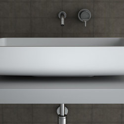 MaestroBath - White Rectangular Modern Bathroom Sink | Elegant Counter Top Wash Basin - A simple rectangular shape with rounded edges demonstrates pure beauty in simplicity. Jimmy is elegantly designed to fit into your bathroom perfectly on a counter top or any other support fixture. Made out of TeknoForm, a durable polymer-based material, Jimmy is available in a clean white color and it may very well be the perfect sink for your contemporary space. Here is more information related to MaestroBath: Services Provided: Luxury Handmade Italian Vessel Sinks, Modern and Contemporary Kitchen and Bath Fixtures .. Areas Served: All United States and International Countries… Business Description: Maestrobath delivers contemporary and modern handmade Italian bathroom sinks and designer faucets to clients with taste of luxury. It carries a wide selection of beautiful and unique Travertine, Crystal and Glass vessel sinks in variety of colors and styles. Maestrobath services homeowners and designers Globally. Furthermore, it has dealer partners across United States and international countries.