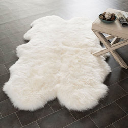 Sheepskin Area Rug - Thick and incredibly soft underfoot, adding texture and lightness to any space, this natural wool rug is also sturdy and hard-wearing. Drape it over a chair, place it at the foot of the bed, or make it the standout piece right beside the coffee table.