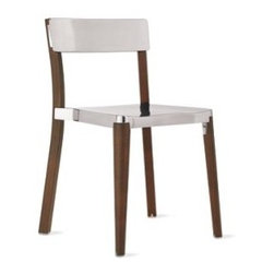 """Emeco - Lancaster Chair - British designer Michael Young has spent 15 years strengthening the connection between modern design and the technical abilities of manufacturers in Asia. """"I see the work not as design but as industrial art where the highest levels of manufacturing have been employed,"""" says the designer. Working from his studio in Hong Kong, Young is known for his expertise in aluminum manufacturing. When he started experimenting with ways to join other materials to aluminum, he contacted U.S.-based Emeco, and a partnership was formed with the Lancaster Collection (2010). The legs are solid ash, harvested from fallen timber near Lancaster, PA (thus the name of the chair); the aluminum seat and back are available in matte black, matte silver or polished silver. """"I am passionate about natural materials that live forever,"""" says Young. """"The wood creates a softer edge, whilst the aluminum keeps it sophisticated."""" Chairs stack up to six high. Seats/backs made in China; legs made in U.S.A. DWR Exclusive"""
