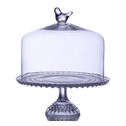 "Home Essentials - Glass Pedestal 9 Dessert Platter with Bird Dome Cover - The Bird Finial on the The Glass Footed Covered Cake Plate deems it a most graceful table centerpiece. A love stage for that decadent dessert, the glass dome allows you to reveal and conceal the cake, cupcakes and even fruits and cheesed displayed on the pedestal cake stand. Simple in shape and yet timeless design on the stand, this cake plate is ideal for weddings, mother's day or any family gathering and special occasion. * Dimensions: 12"" Tall, 9"" Diameter * Dome: 7.5 inside Diameter x 7.75H (including bird decoration on top)"