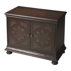 Butler Specialty Furniture - Heritage Console Cabinet 1145070 - Understated in its elegance, this console cabinet is the product of meticulous craftsmanship. Handcrafted from gmelina wood solids, choice maple veneers and wood products, it features a distinctive design of individually hammered nails adorning the door panels. In addition it provides ample interior storage including one adjustable shelf behind doors, antique silver hardware and a lightly distressed walnut finish. Only listed product included.