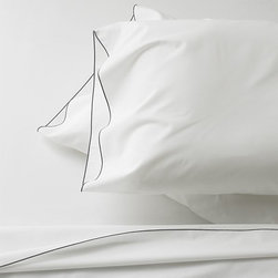 Belo Gray Sheet Set - I'm a sucker for details, and the thin gray edging on these sheets and pillowcases is just right.