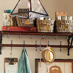 """French Cafe Wall-Mount Wood & Metal Coat Rack - Designed after a coat rack we spotted in Paris, our space-saving entryway piece features a broad shelf for storing essentials or displaying decorative items, and lots of hooks below for hanging coats, scarves and bags. 49.5"""" wide x 12"""" deep x 15"""" high Made of wood and aluminum with a bronze finish. Mounting hardware included. Catalog / Internet only."""