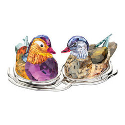 Swarovski - Swarovski Mandarin Ducks Topaz - Swarovski Mandarin Ducks Topaz  -  Size: 6.25 Inches Wide x 2.5 Inches Tall  -  Hand Crafted In Fine Swarovski Silver Crystal  -  Made In Austria  -  Known for forming life-long partnerships, Mandarin ducks are a powerful symbol of long-lasting love and togetherness. The male?s striking plumage sparkles in a stunning combination of rich crystal colors, including Topaz, Amethyst, and Indian Sapphire crystal. Inspired by the waves on the surface of a pond, the silver-tone metal display is not attached to the ducks, allowing you to place them in different positions.  -  Released In 2012