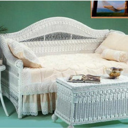 Yesteryear Wicker - Classic Wicker Daybed - YY054 - Shop for Daybeds from Hayneedle.com! The Classic Wicker Daybed gives you the option to add a trundle for convenient storage to complete your daybed. The daybed boasts fine traditional wicker construction and traditional antique style with an elegantly arched back. This high-quality daybed makes a magnificent room even better especially when you add its coordinating tables all of which add casual airy beauty to any bedroom sunroom or enclosed porch. This daybed offers a functional daily seating and a lovely bed for yourself or guests on any occasion. Choose brown wash white or whitewash finish. Link spring included. A trundle is an extra mattress frame stored beneath a daybed which slides out to provide additional sleeping space when needed. The optional trundle packages include a metal pop-up style trundle. They can be left in the lowered position or elevated in the pop-up position to align with the primary daybed mattress. The pop-up feature allows the daybed to transform from a twin-size daybed into a king-size bed. This product arrives in two packages with simple assembly: Sides attach to the back with minimal effort. Creating a king-size bed out of a daybed and a pop-up trundle is easy and with the Create-A-King mattress connector it will be so comfortable you'll never know it comprises two twin mattresses. The Create-A-King mattress connector is available for purchase in the shopping cart.