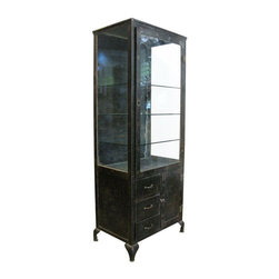 """Pre-owned 1920s Steel Medical Cabinet - A Beautifully proportioned tall 1920s stripped steel medical cabinet with original wavy glass door and sides.    A single hinged doors leads to a 38""""  tall interior vitrine. The door swings smoothly, the lock is missing. Three glass shelves come with this cabinet and there is room inside for one more shelf.  Three 5"""" tall full depth sliding drawers are bellow on the left and a 17""""  by 10""""  full depth storage space with a hinged door is bellow on the right.    The cabinet has been stripped to the bare metal on all exterior surfaces and sealed against rust. The rich patina has  plenty of character and its wear is consistent with age and use, some fading to the finish. (See pictures.)"""