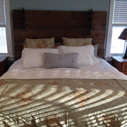 Reclaimed Barn Door Design Ideas from Projects in NYC, New Jersey & Connecticut - Reclaimed Barn Door Re-Purposed into a Headboard for this King Size Bed.  All original hardware was left on the door.