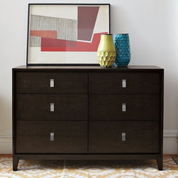 Niche 6-Drawer Dresser - Furniture with a friendly bedside manner. This dresser offers sleek storage with generous side-by-side drawers in a range of practical sizes for clothing, accessories and linens. The brushed-nickel accents and tapered legs create a classic look.