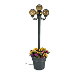 Patio Living Concepts - Planter Stand Park Lamp w Bronze Globes - A gorgeous and intimate ambience wafts from the light provided by each fascinating bronze globe on this art deco inspired lamp post.  It takes a step away from traditional luminaries, however, by its inclusion of a distinctive and unique planter base.  Here is a park style lamp that has a unique twist to it.  This park lamp has bronze globes for a less harsh light and also is in a planter stand.  This black post park light emerges from a beautiful iron resin planter perfect for your favorite blooms. * Park Bronze Globe Planter. Black w/ Iron Resin Planter. 22x22. 5x20. Replant those gorgeous sunflowers in your 3 Light Lamp Post w/ Planter Base.   Lovely, innovative, and reminiscent of old world craftsmanship, this is a piece to be enjoyed with a stellar novel and a cool glass of Pinot Grigio