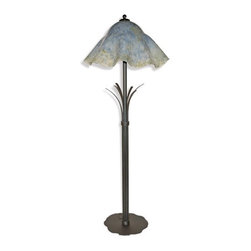 Mathews & Company - Wrought Iron Buttercup Floor Lamp with Glass Shade - A big brother to its matching table lamp, the Buttercup floor lamp adds length to the design. The same gorgeous blue and yellow hand blown glass shade rests at the top, while the wrought iron stem exudes greater elegance as it stretches toward the floor with its bundled leaf-like strands. The base, which features gentle scallops, speaks to the floral emphasis of the design while lending support to the fixture. Romantic and wistful, the Buttercup collection will not only add needed lighting to your home, but also add a gentle beauty to its decor. Pictured in Cloudy Gray shade and Black finish.